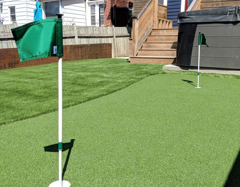 Backyard golf green with PushNPutt flags