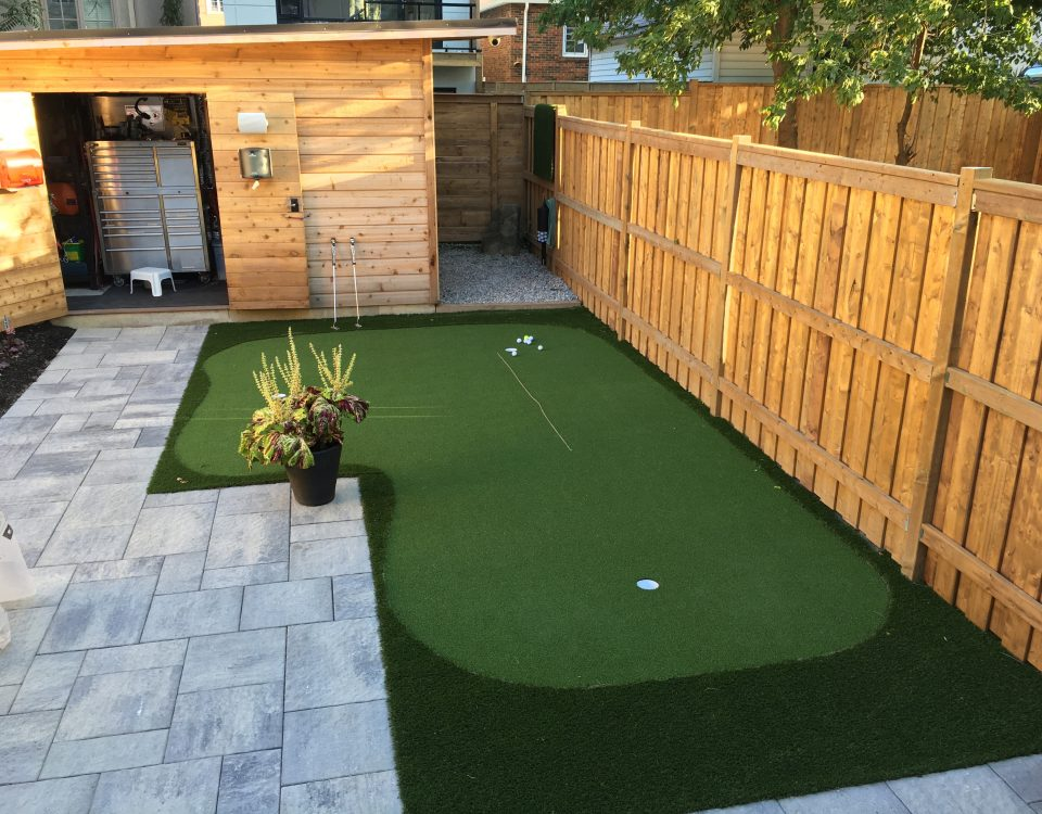 Off patio golf green keeps the backyard open for kids