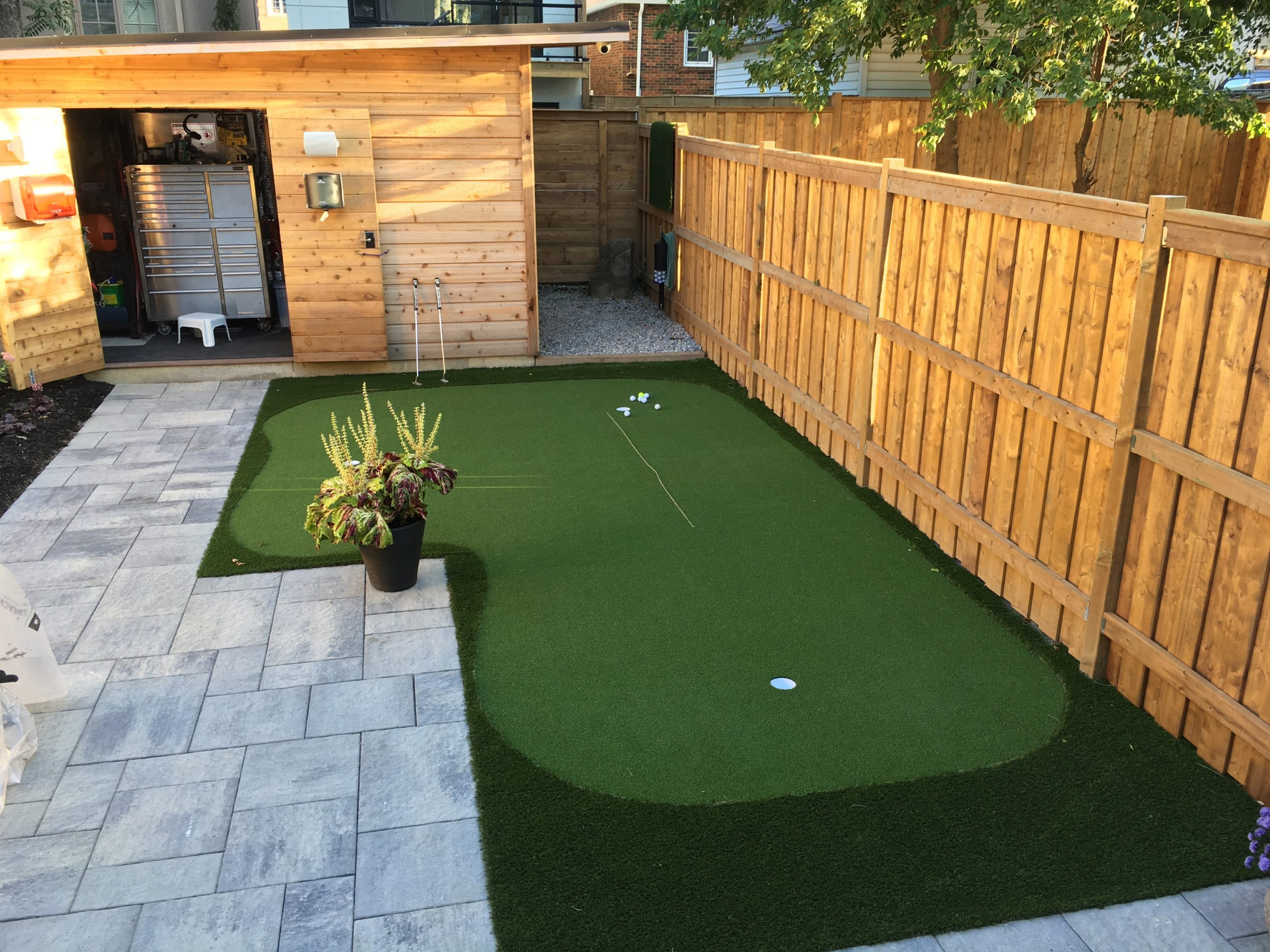 Strategically placed golf green keeps the backyard use for ...