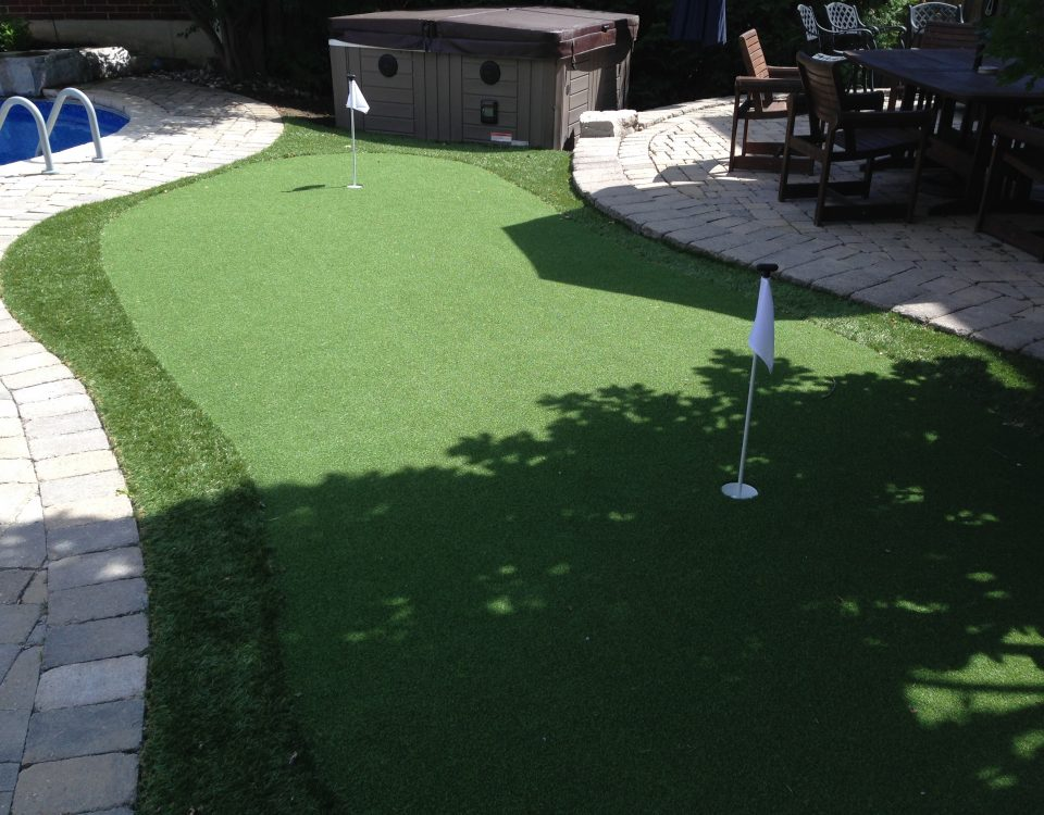 Pool-side golf green equals fun backyard